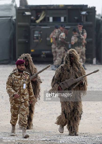 Qatari army troops some of them dressed in camouflage outfits attend the final day of joint military exercise with the French armed forces entitled...
