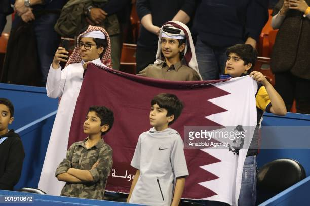 Qatari children hold a flag of Qatar during the Qatar ExxonMobil Open 2018 Tennis Tournament Men's Final match between Andrey Rublev of Russia and...