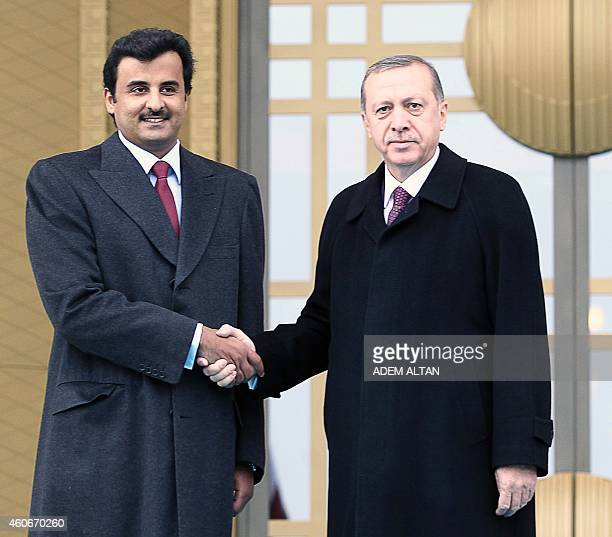 Qatari Crown Prince Sheikh Tamim bin Hamad bin Khalifa alThani is welcomed by Turkish President Recep Tayyip Erdogan prior to their meeting at the...