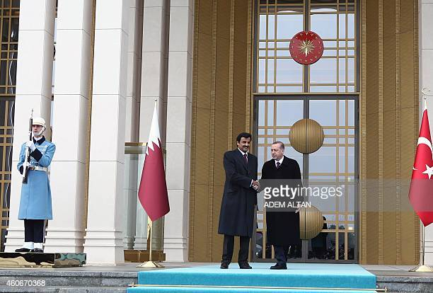 Qatari Crown Prince Sheikh Tamim bin Hamad bin Khalifa alThani is welcomed by Turkish President Recep Tayyip Erdogan prior to a meeting at the...