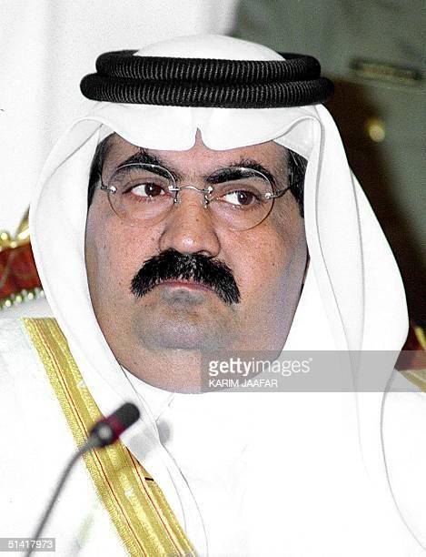 "Qatari Emir, Sheikh Hamad Ben Khalifa Al Thani, attends the 26 th session of the Consultative Council "" Al Choura"" in Doha 30 November 1997."