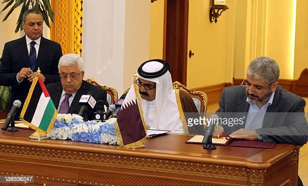 Qatari Emir Sheikh Hamad Bin Khalifa AlThani Palestinian President Mahmoud Abbas and Hamas leader Khaled Meshaal attend a signing ceremony in Doha on...