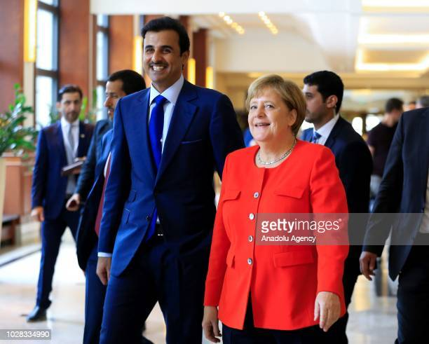 Qatari Emir Sheikh Tamim bin Hamad alThani and German Chancellor Angela Merkel attend Germany and Qatar Economic Conference in Berlin Germany on...