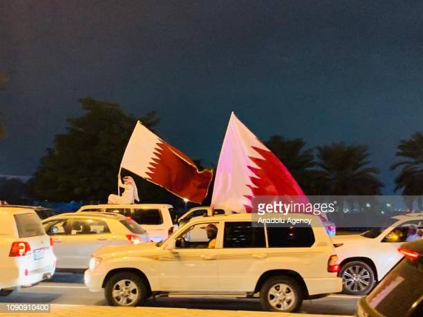 Qatari fans celebrate after Qatar beat the United Arab Emirates 40 to advance to the 2019 AFC Asian Cup final for the first time in Doha Qatar on...