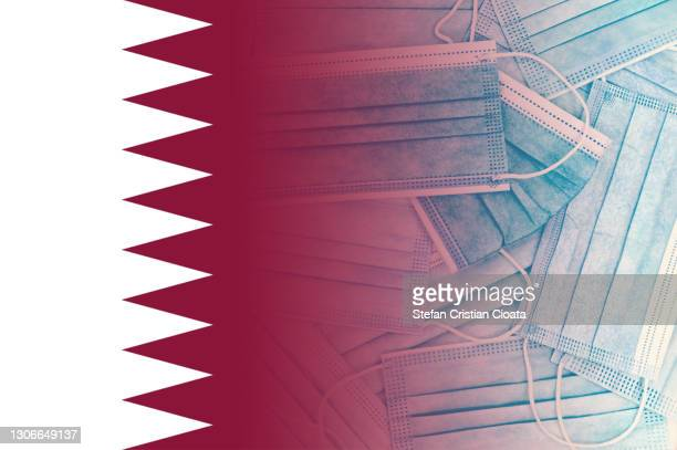 qatari flag over face protective masks - qatar stock pictures, royalty-free photos & images