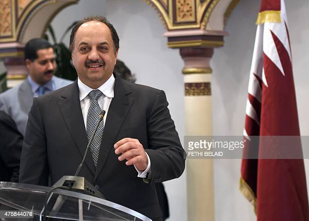 Qatari Foreign Minister Khalid bin Mohamed alAttiyah arrives for a press conference following his meeting with his Tunisian counterpart Taieb...