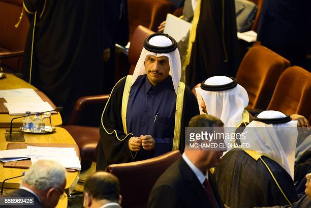 Qatari Foreign Minister Mohammed bin Abdulrahman alThani attends an emergency foreign ministers meeting in the Egyptian capital Cairo on December 9...
