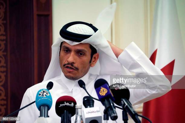 Qatari Foreign Minister Mohammed bin Abdulrahman alThani holds a press conference with the US Secretary of State in the capital Doha on October 22...