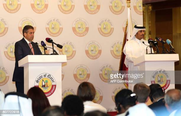Qatari Foreign Minister Sheikh Mohammed bin Abdulrahman AlThani and his German counterpart Sigmar Gabriel give a joint press conference in the Qatari...