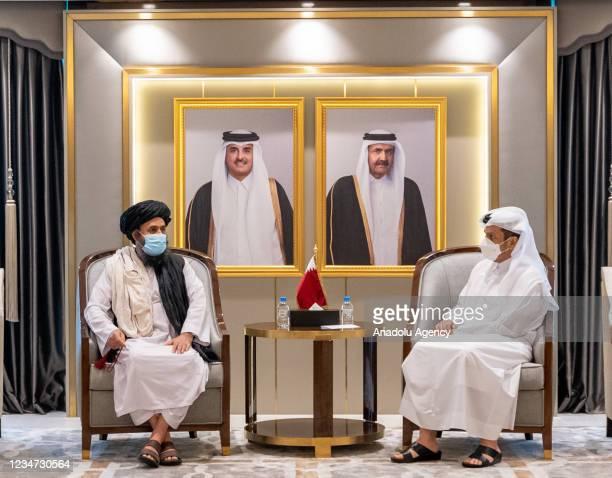 Qatari Foreign Minister Sheikh Mohammed Bin Abdulrahman Al-Thani meets with Head of the Taliban's Political Bureau in Qatar Mullah Abdul Ghani...