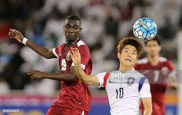 Qatari forward Almoez Ali and Korea Republic's midfielder Ryu Seungwoo jump to head the ball during their AFC U23 Championship semifinal football...