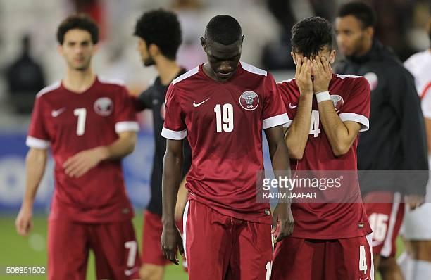 Qatari forward Almoez Ali and midfielder Ahmas Moein Doozandeh react after losing their AFC U23 Championship semifinal football match between Qatar...