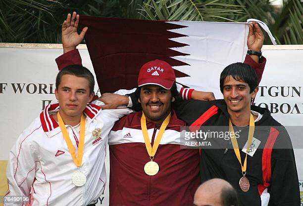 Qatari gold medalist Masud alAbda Russia's silver medalist Artem Nekrasov and Emirati bronze medalist Mohammed Dhahi pose on the podium after winning...