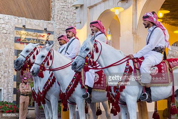 Qatari guards on Arabian horses in souq