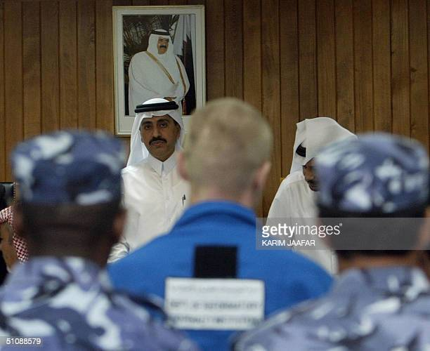 Qatari Judge Abdullah AlSaadi looks at one of two Russian intelligence agents accused of the February 13 killing of former Chechen president...