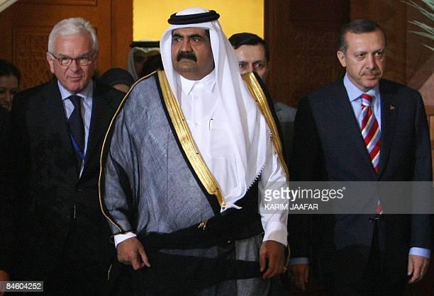 Qatari leader Sheikh Hamad bin Khalifa al-Thani walks with Turkish Prime Minister Recep Tayyip Erdogan and the President of the European Parliament...