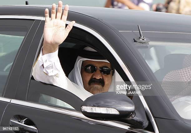 Qatari leader Sheikh Hamad bin Khalifa al-Thani waves during the Gulf emirate's National Day celebrations in Doha on December 18, 2009. AFP...