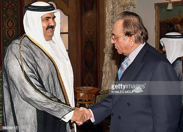 Qatari leader Shiekh Hamad bin Khalifa alThani shakes hands with Pakistani Foreign Minister Khurshid Kasuri during their meeting in Doha 31 October...