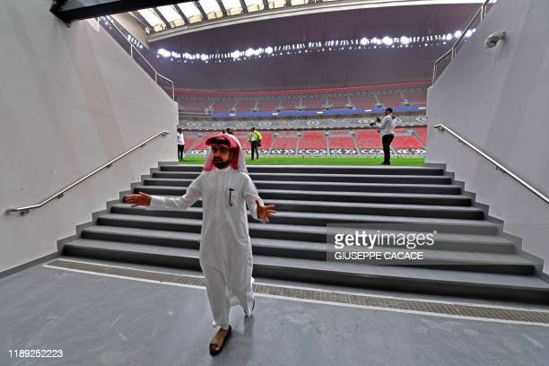 Qatari man walks on the staircase leading to the pitch of Qatar's new al-Bayt Stadium in the capital Doha, on December 17 which will host matches of...