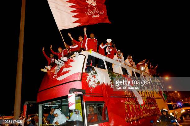 Qatari national football team players and staff celebrate at Doha Corniche in Doha on February 2 as they come back from the United Arab Emirates with...