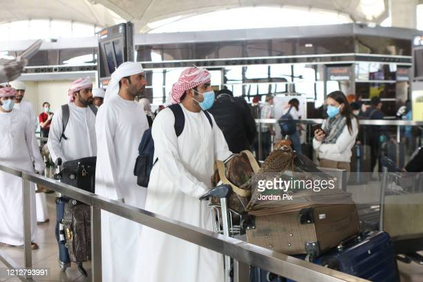 Qatari passengers travel back to their country carrying falcons they have brought with them for desert hunting as hundreds of passengers depart the...
