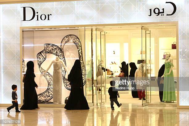 Qatari people in their traditional clothes called dishdasha and abaya are pictured at the luxury part of Villagio shopping mall on December 29 2010...