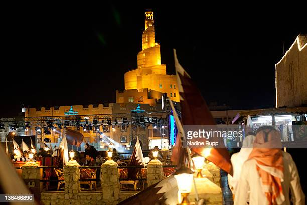 Qatari people in their traditional clothes called dishdasha and abaya are pictured at Souq Waqif on December 21 2011 in Doha Qatar The FIFA World Cup...