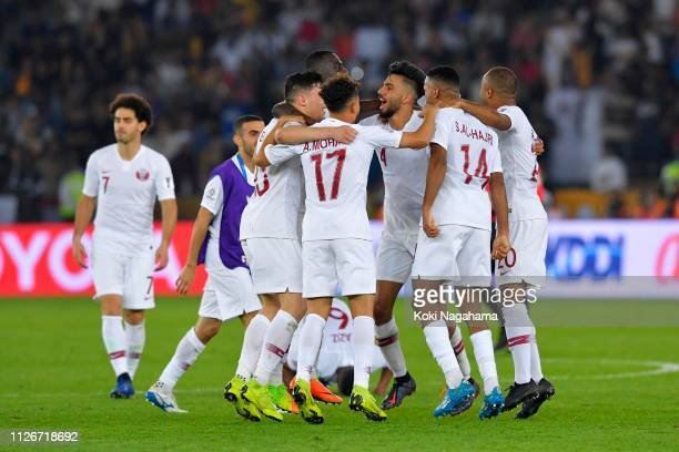 Qatari players celebrate their victory in the AFC Asian Cup final match between Japan and Qatar at Zayed Sports City Stadium on February 01, 2019 in...