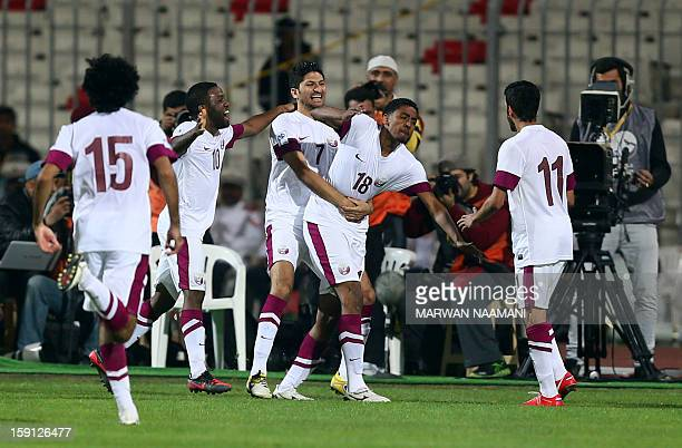 Qatari players jubilate after scoring a goal against Oman during the two teams match in the 21st Gulf Cup in Manama on January 8 2013 AFP...