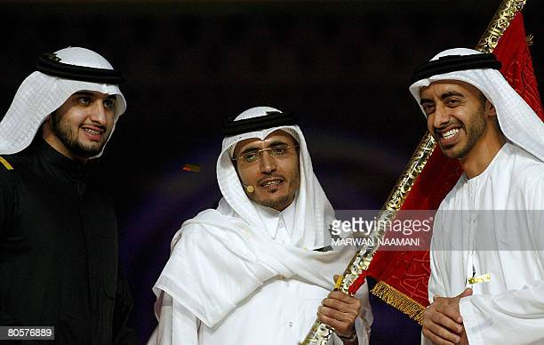 Qatari poet Khalil alShebrami alTamimi winner of 'One Million Dirham Poet' TV program stands with Emirati Foreign Minister Sheikh Abdullah bin Zayed...