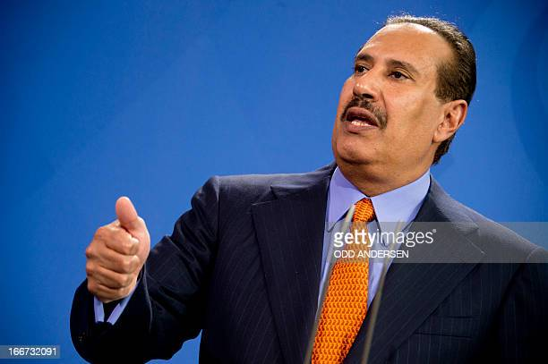 Qatari prime minister Hamad bin Jassim bin Jaber Al Thani addresses a joint press conference with German Chancellor at the Chancellery in Berlin on...