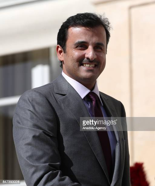 Qatari Sheikh Tamim bin Hamad Al Thani is welcomed by French President Emmanuel Macron at the Elysee Palace in Paris France on September 15 2017