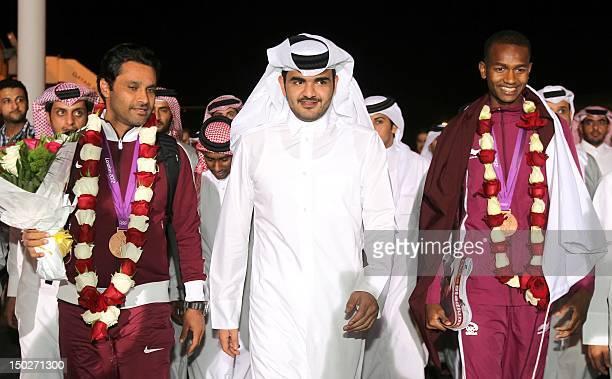 Qatari Shiekh Joaan bin Hamad bin Khalifa al-Thani, son of the Emir of Qatar welcomes Qatar's Nasser al-Attiyah , bronze medalist in the skeet men's...