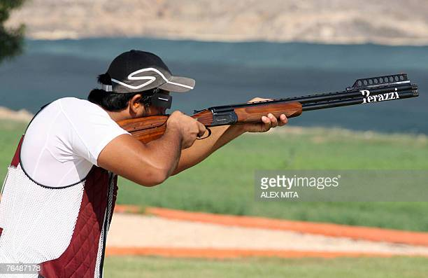 Qatari shooter Rashid alAthba prepares to fire during the double trap competition of the first day of the ISSF World Shooting Championships held in...
