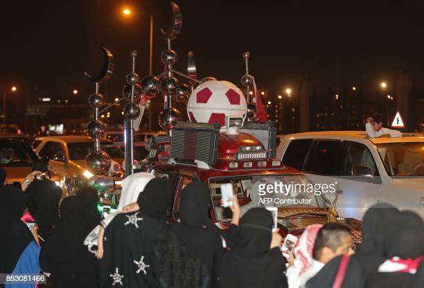 Qatari take to the streets of Doha to welcome back the Emir upon his returned from his first trip abroad during the ongoing Gulf diplomatic crisis on...