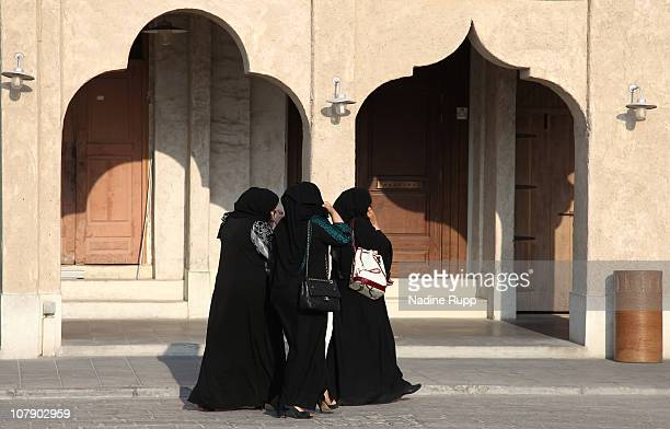 Qatari women in their traditional clothes called abaya are pictured at Souq Waqif on January 02 2011 in Doha Qatar The Souq Waqif a big bazaar with...