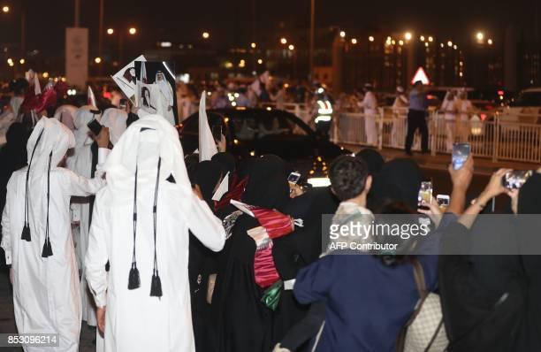 Qataris gather in the streets of Doha to welcome back the Emir upon his returned from his first trip abroad during the ongoing Gulf diplomatic crisis...