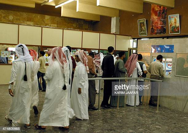 Qataris stands in line to buy tickets of Mel Gibson's film 'The Passion of the Christ' in Doha 21 March 2004 The film made its debut in Qatar the...