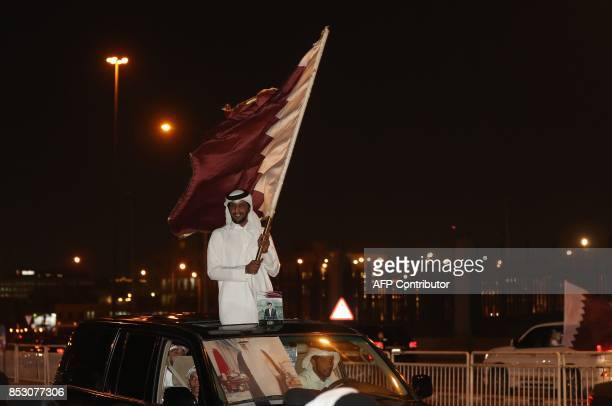 Qataris take to the streets of Doha to welcome back the Emir upon his return from his first trip abroad during the ongoing Gulf diplomatic crisis on...