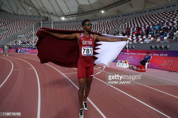 Qatar's Abderrahman Samba celebrates after winning the final of the 400m Hurdles men during the second day of the 23rd Asian Athletics Championships...