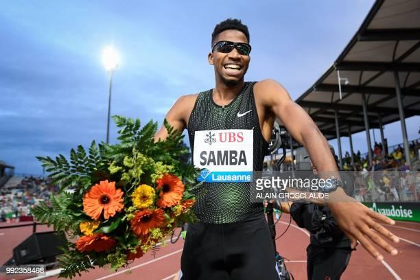 Qatar's Abderrahman Samba celebrates after winning the Men's 400m hurdles during the IAAF Diamond League athletics meeting Athletissima in Lausanne...