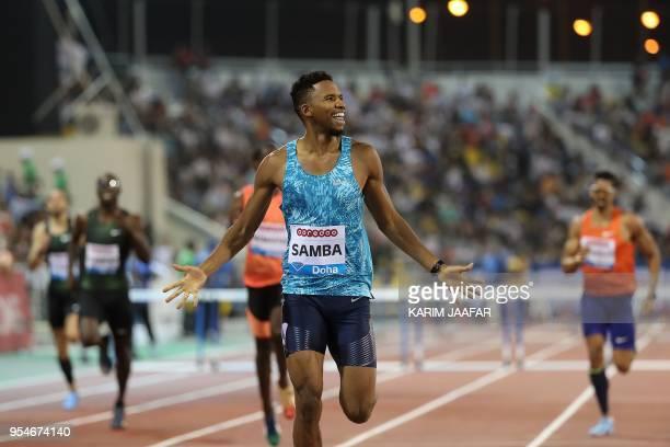 Qatar's Abderrahman Samba celebrates as he crosses the finish line to win the 400 metres hurdles during the Diamond League athletics competition at...