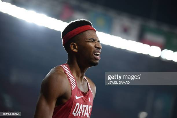 Qatar's Abderrahman Samba celebrates winning the final of the men's 400m hurdles athletics event during the 2018 Asian Games in Jakarta on August 27...