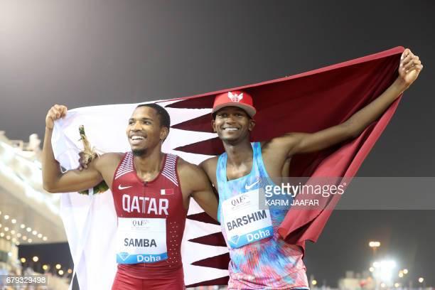 Qatar's Abderrahman Samba celebrates with high jump athlete Mutaz Barshim after winning the men's 400 metres hurdles during the Diamond League...