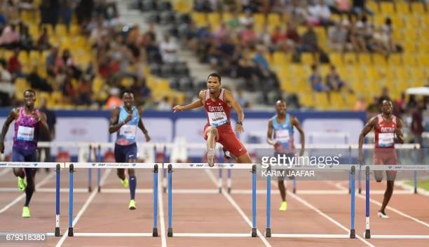 Qatar's Abderrahman Samba leads the men's 400 metres hurdles during the Diamond League athletics competition at the Suhaim bin Hamad Stadium in Doha...
