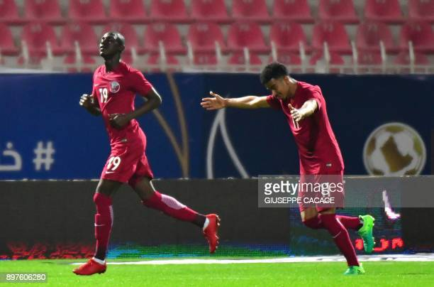 Qatar's Akram Afif and Almoez Ali react after scoring a goal during the 2017 Gulf Cup of Nations football match between Qatar and Yemen at the Sheikh...