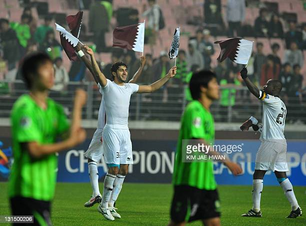 Qatar's Al Sadd players celebrate their victory in the AFC Champions League football final match against South Korea's Jeonbuk Hyundai Motors in...