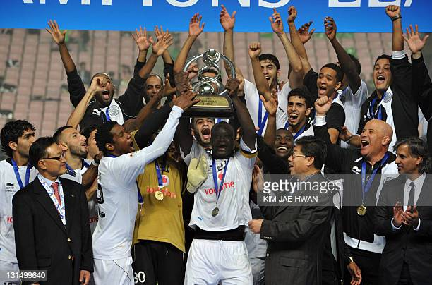 Qatar's Al Sadd players celebrate with the trophy after winning the AFC Champions League football final against South Korea's Jeonbuk Hyundai Motors...