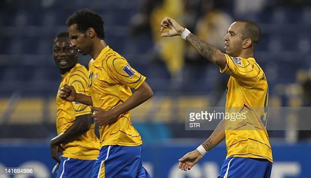 Qatar's Al-Gharafa Brazilian player Tardelli celebrates after scoring against Saudi Arabia's Al-Hilal club during their Group D AFC Championship...