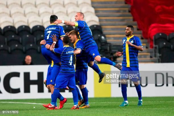 Qatar's alGharafa celebrate scoring a goal during the AFC Champions League Round 1 Group Match between alJazira vs alGharafa at the Mohammed Bin...